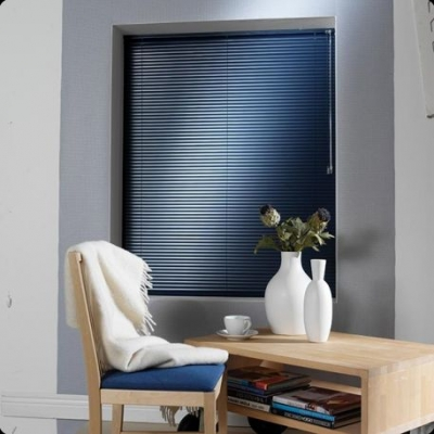 aluminum blinds metalic blue in office