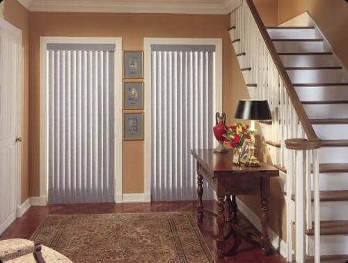 vertical blind dual interior gray on rust colored wall