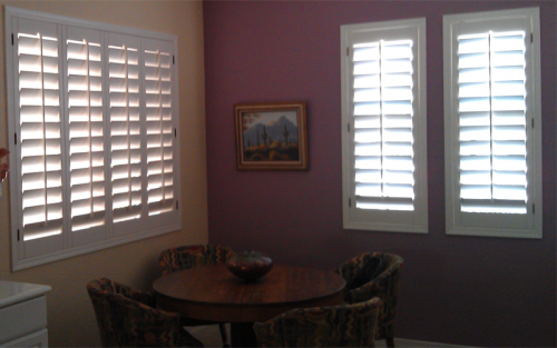 wood shutters interior white on multi colored wall